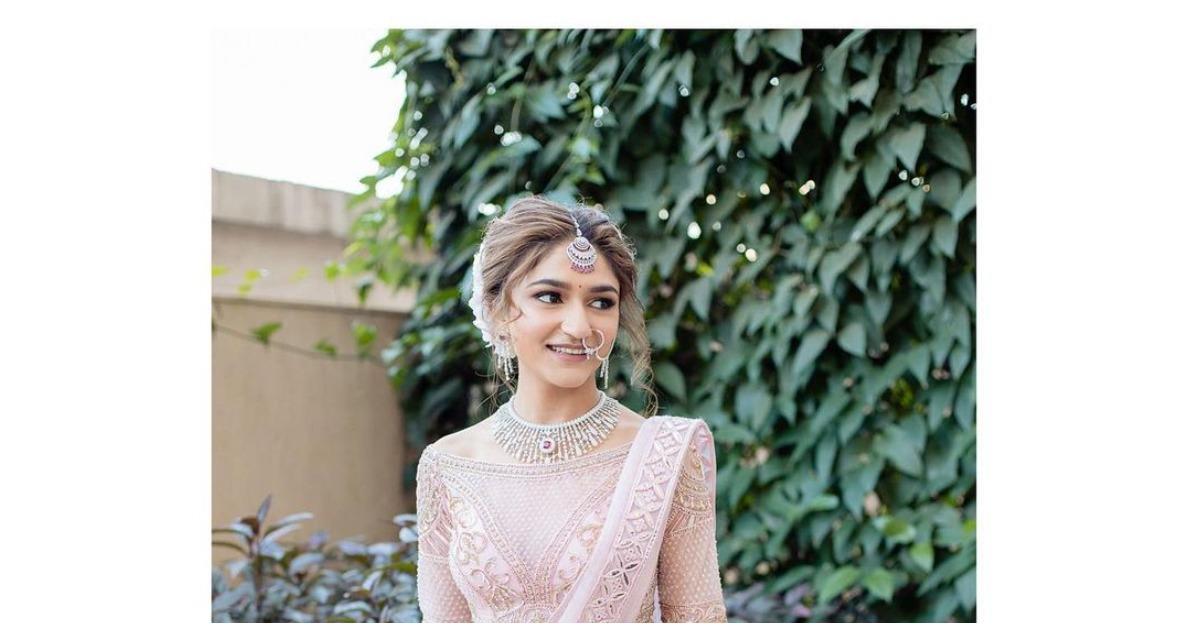 FSP bride Diksha Patel made a vision of a bride in the light pink Falguni Shane Peacock Lehenga